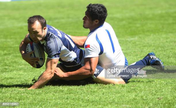 Scotland's Michael Adamson in action with Samoa's Alafoti Fa'osiliva during day two of the Emirates Airline Edinburgh Sevens Festival in the IRB...