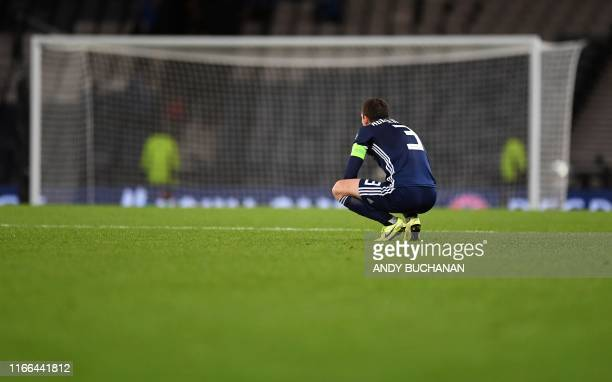 Scotland's midfielder Andy Robertson reacts following the UEFA Euro 2020 Qualifying 1st round Group I football match between Scotland and Russia at...