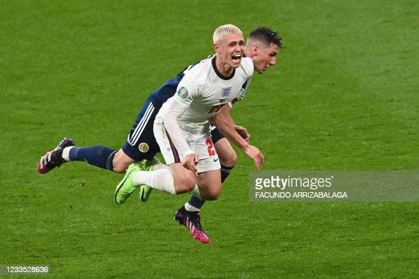 Scotland's midfielder Billy Gilmour challenges England's midfielder Phil Foden during the UEFA EURO 2020 Group D football match between England and...