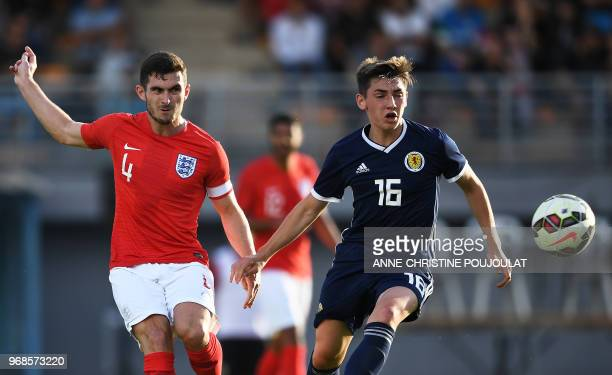 Scotland's midfielder Billy Gilmour vies with England's midfielder Lewis Cook during the Festival International Espoirs Maurice Revello Tournament...