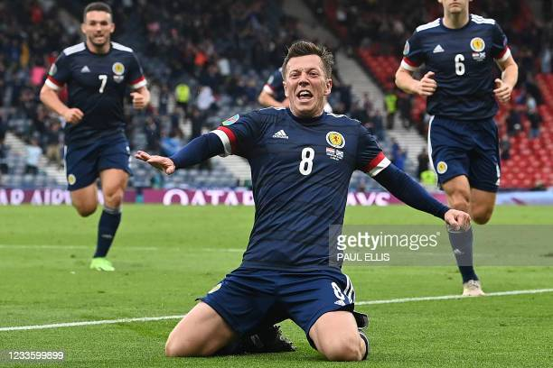 Scotland's midfielder Callum McGregor celebrates after scoring the equaliser during the UEFA EURO 2020 Group D football match between Croatia and...
