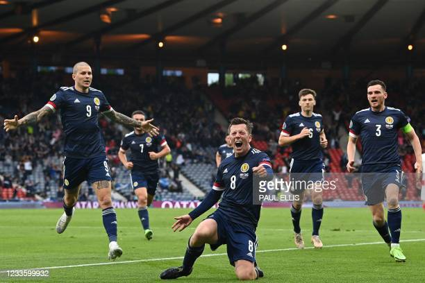 Scotland's midfielder Callum McGregor celebrates after scoring the equalsier during the UEFA EURO 2020 Group D football match between Croatia and...