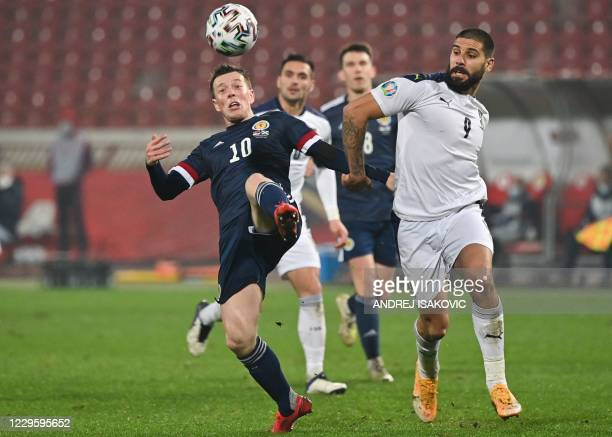 Scotland's midfielder Callum McGregor fights for the ball with Serbia's forward Aleksandar Mitrovic during the Euro 2020 play-off qualification...