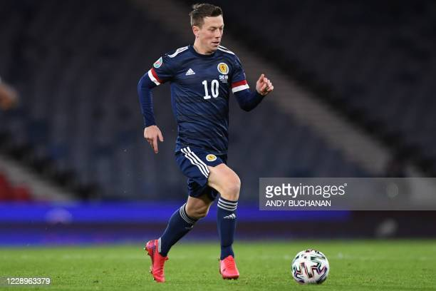 Scotland's midfielder Callum McGregor runs with the ball during the Euro 2020 playoff semi-final football match between Scotland and Israel at...