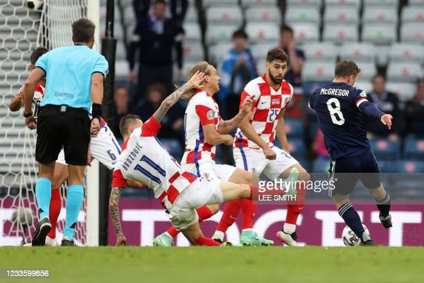 Scotland's midfielder Callum McGregor shoots to score the equaliser during the UEFA EURO 2020 Group D football match between Croatia and Scotland at...