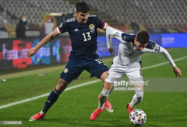 Scotland's midfielder Callum Paterson figths for the ball with Serbia's defender Filip Mladenovic during the Euro 2020 play-off qualification...