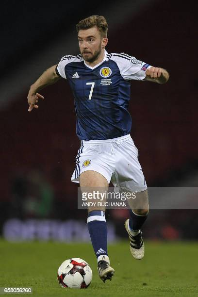 Scotland's midfielder James Morrison runs with the ball during the World Cup 2018 qualification football match between Scotland and Slovenia at...
