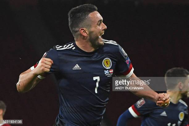 Scotland's midfielder John McGinn celebrates after scoring their second goal during the FIFA World Cup Qatar 2022 qualification football match...