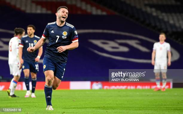 Scotland's midfielder John McGinn celebrates scoring his team's second goal during the FIFA World Cup Qatar 2022 Group F qualification football match...