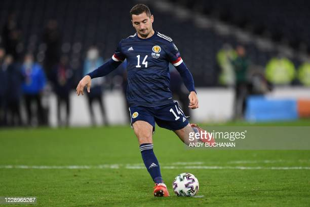 Scotland's midfielder Kenny McLean takes their fifth penalty to win the penalty shoot-out during the Euro 2020 playoff semi-final football match...