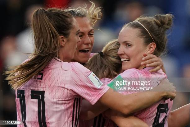 Scotland's midfielder Kim Little is congratulated by teammates after scoring a goal during the France 2019 Women's World Cup Group D football match...