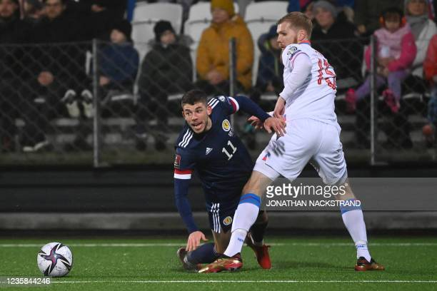 Scotland's midfielder Ryan Christie and Faroes' defender Odmar Faero vie for the ball during the FIFA World Cup Qatar 2022 qualification Group F...
