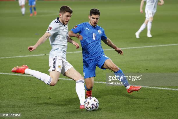 Scotland's midfielder Ryan Christie tries to cross as he is marked by Israel's midfielder Manor Solomon during the 2022 FIFA World Cup qualifier...