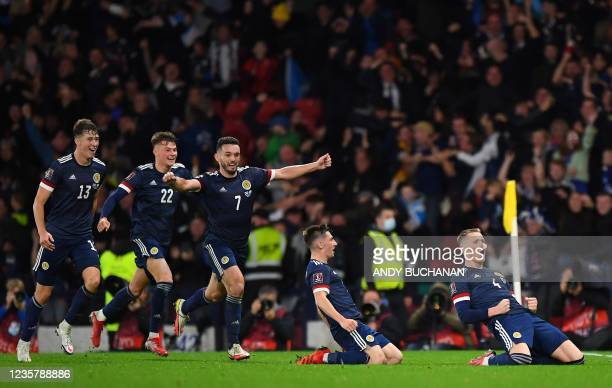 Scotland's midfielder Scott McTominay celebrates scoring his team's third goal during the FIFA World Cup Qatar 2022 Group F qualification football...