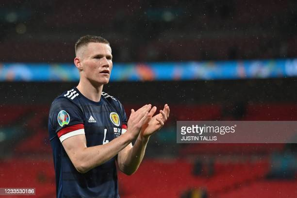 Scotland's midfielder Scott McTominay claps after the UEFA EURO 2020 Group D football match between England and Scotland at Wembley Stadium in London...