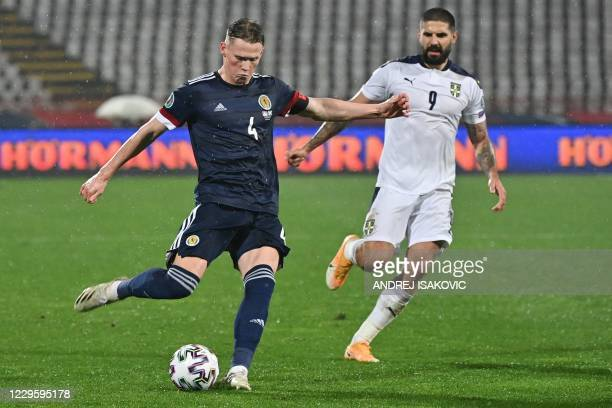 Scotland's midfielder Scott McTominay fights for the ball Serbia's forward Aleksandar Mitrovic during the Euro 2020 play-off qualification football...