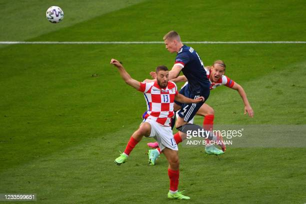 Scotland's midfielder Scott McTominay vies for the ball with Croatia's midfielder Nikola Vlasic during the UEFA EURO 2020 Group D football match...