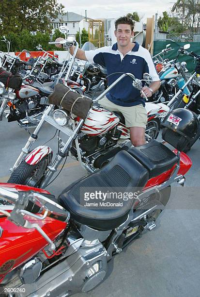 Scotlands Nathan Hines sits on a Bandidos bike at the Ridges Hotel on October 17, 2003 in Caloundra, Australia.