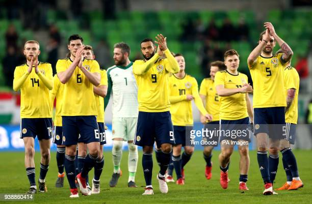 Scotland's Oliver McBurnie Scott McKenna Matt Phillips and Charlie Mulgrew applaud the fans after winning 10 against Hungary at the end of the...