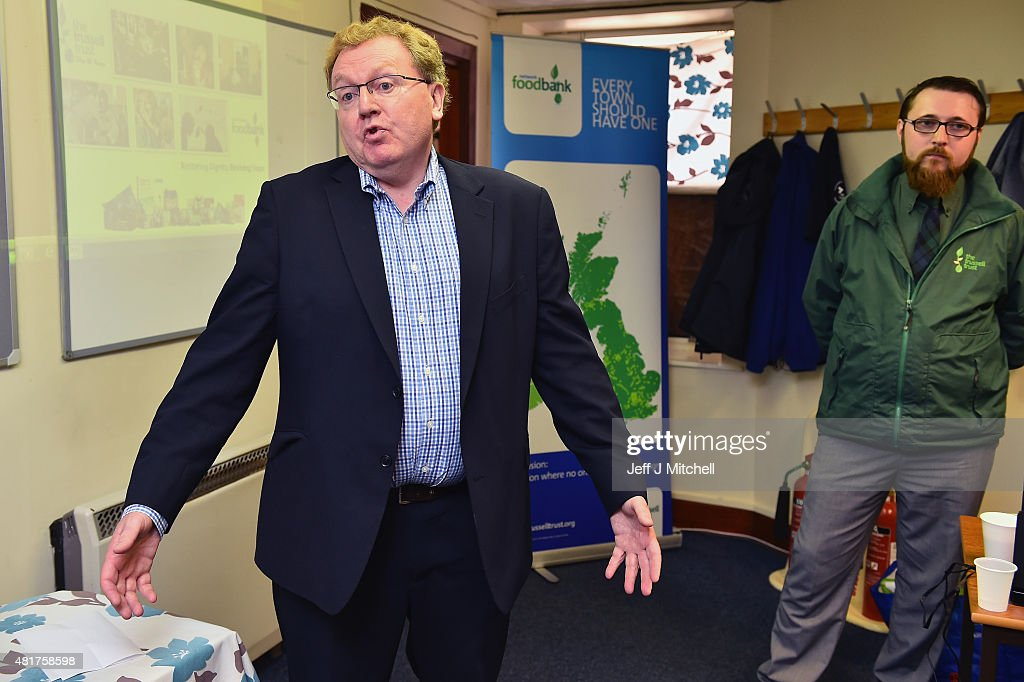 Scotland's only Conservative MP David Mundell opens a foodbank at the Apex Centre to help people struggling with welfare reform on July 24, 2015 in Dumfries, Scotland. The Apex Centre is just yards from another foodbank run by the First Base Agency, which has criticised Conservative welfare policies which it said are directly contributing to poverty and foodbank use in Dumfries.