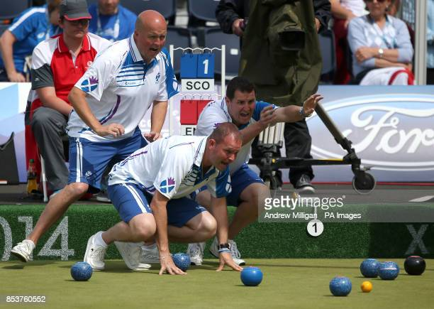 Scotland's Paul Foster Neil Speirs and David Peacock shout at a bowl against England in the Men's Fours final at Kelvingrove Lawn Bowls Centre during...