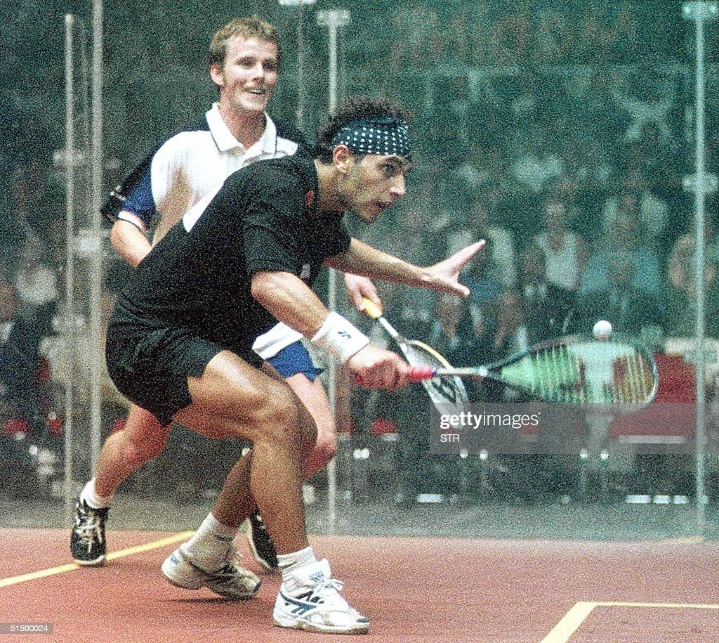 Scotland's Peter Nicol (back) beats Egyptian Ahmad : News Photo