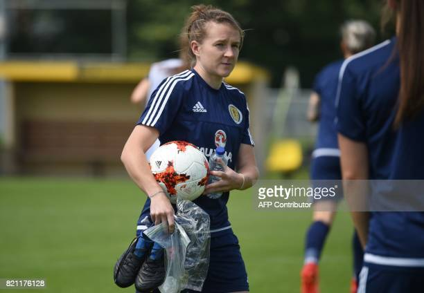 Scotland's player Frankie Brown holds a ball and her shoes during a training session in Woudenberg on July 21 during the UEFA Women's Euro 2017...