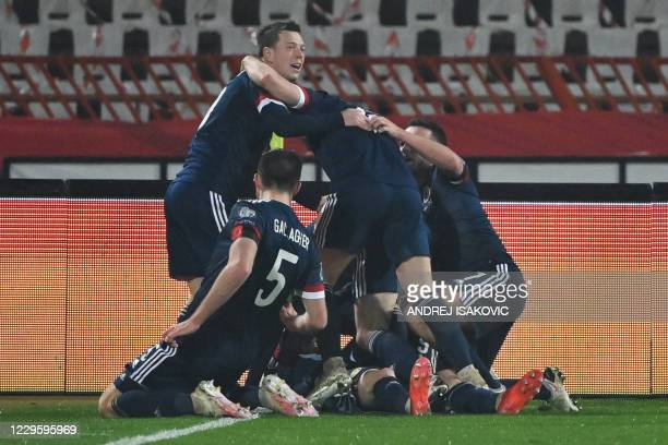Scotland's players celebrate after scoring a goal during the Euro 2020 play-off qualification football match between Serbia and Scotland at the Red...