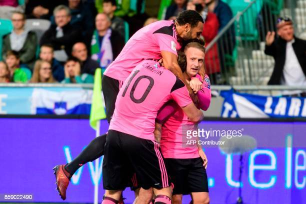 Scotland's players celebrate after scoring a goal during the FIFA World Cup 2018 qualifier football match between Slovenia and Scotland at the...