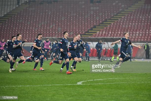 Scotland's players celebrate after winning the Euro 2020 play-off qualification football match between Serbia and Scotland at the Red Star Stadium in...