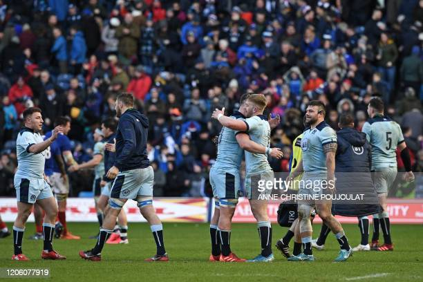 Scotland's players celebrate on the pitch after the Six Nations international rugby union match between Scotland and France at Murrayfield Stadium in...