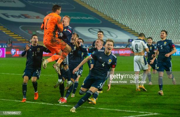 Scotland's players celebrate the winning penalty during the UEFA Euro 2020 Qualifier between Serbia and Scotland at the Stadion Rajko Mitic on...