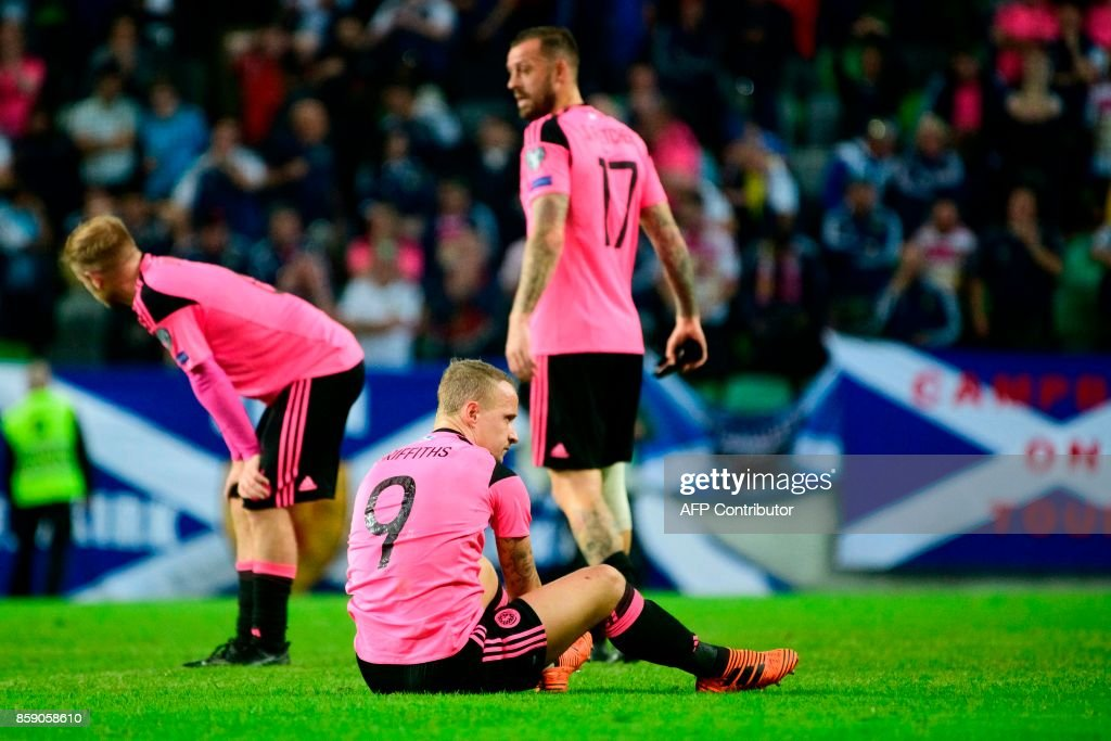 Scotland's players react after the draw during the FIFA World Cup 2018 qualifier football match between Slovenia and Scotland at the Stozice stadium in Ljubljana, on October 8, 2017. / AFP PHOTO / Jure Makovec