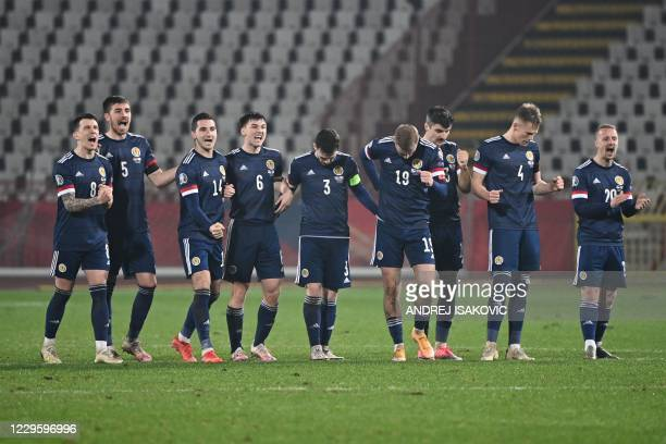 Scotland's players reacts during the penalty shootout as part of the Euro 2020 play-off qualification football match between Serbia and Scotland at...