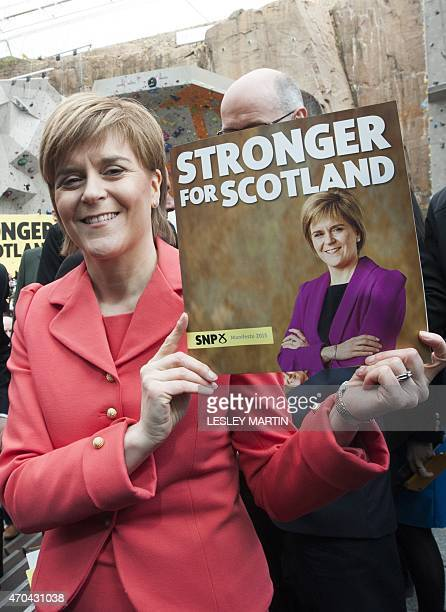Scotland's proindependence First Minister Nicola Sturgeon holds up a copy of the Scottish National Party manifesto following the manifesto launch in...