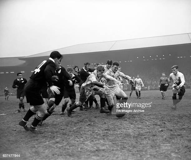 Scotland's Robert MacEwen centre and Hugh McLeod second right go for a lose ball