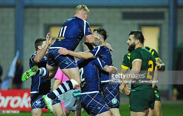 Scotland's Ryan Brierley celebrates scoring his sides first try with teammates during the Four Nations match between the Australian Kangaroos and...