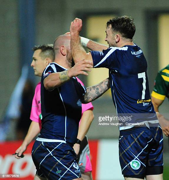 Scotland's Ryan Brierley right celebrates scoring his sides first try with teammate Lewis Tierney during the Four Nations match between the...