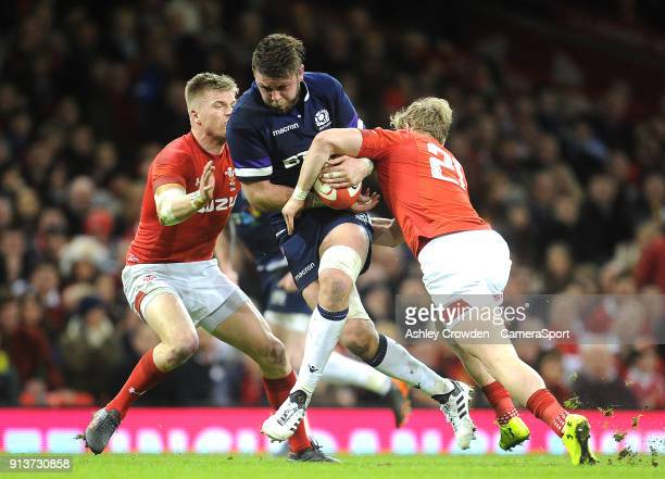 Scotland's Ryan Wilson is tackled by Wales' Aled Davies during the NatWest Six Nations Championship match between Wales and Scotland at Principality...