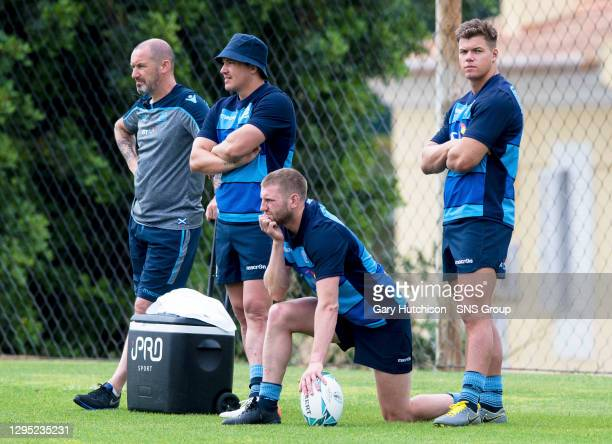 Scotland's Sam Johnson, Finn Russell and Huw Jones watch on from the sidelines