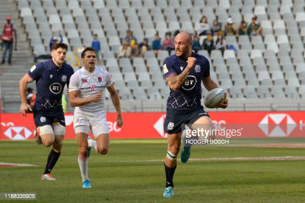 Scotland's Sam Pecqueur runs with the ball to score a try during the HSBC World Rugby Sevens Series men's rugby match between England and Scotland at...