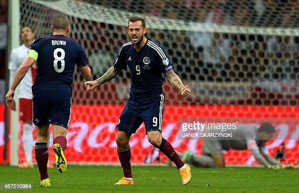 Scotland's Scott Brown and Steven Fletcher celebrates scoring during the UEFA Euro 2016 Group D qualifying football match Poland vs Scotland in...
