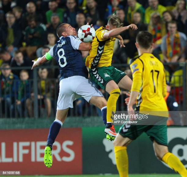 Scotland's Scott Brown vies with Lithuania's Vykintas Slivka during the FIFA World Cup 2018 qualification football match between Lithuania and...