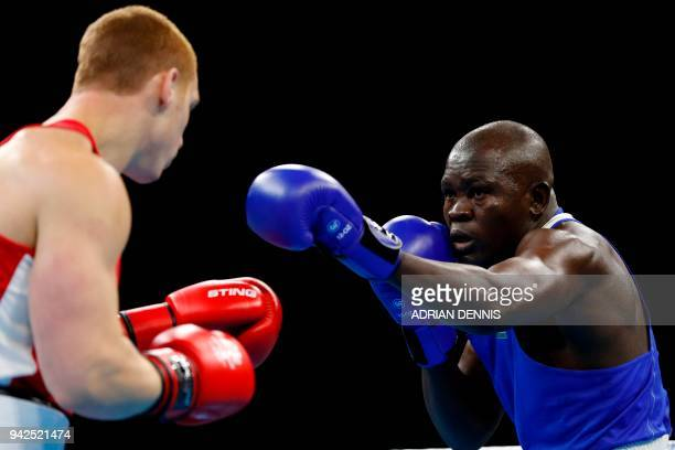 Scotland's Scott Forrest fights against Kenya's Elly Ochola during the mens heavy category preliminary boxing match during the 2018 Gold Coast...