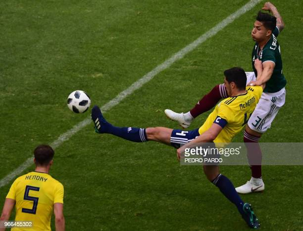 Scotland's Scott McKenna and Mexico's Carlos Salcedo vie for the ball during their international friendly football match at the Azteca stadium in...