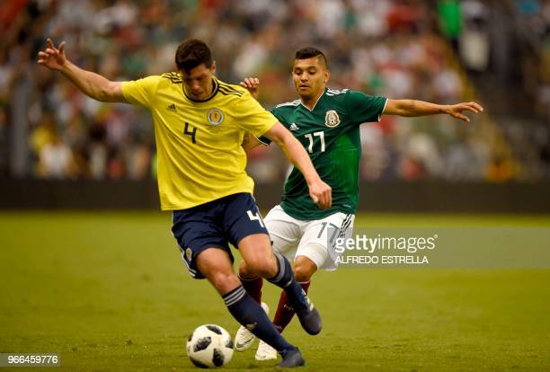 Scotland's Scott McKenna and Mexico's Jesus Corona vie for the ball during their international friendly football match at the Azteca stadium in...