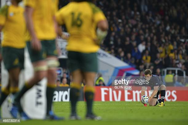 Scotland's scrum half and captain Greig Laidlaw prepares to kick a conversion during a quarter final match of the 2015 Rugby World Cup between...