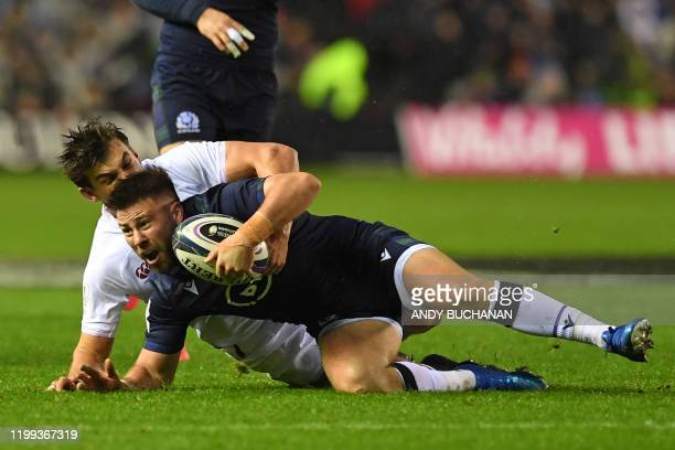 Scotland's scrumhalf Ali Price is tackled by England's fullback George Furbank during the Six Nations international rugby union match between...