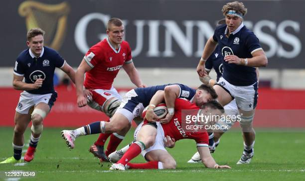 Scotland's scrum-half Ali Price tackles Wales' wing Josh Adams during the 2020 Six Nations Championship rugby union match between Wales and Scotland...