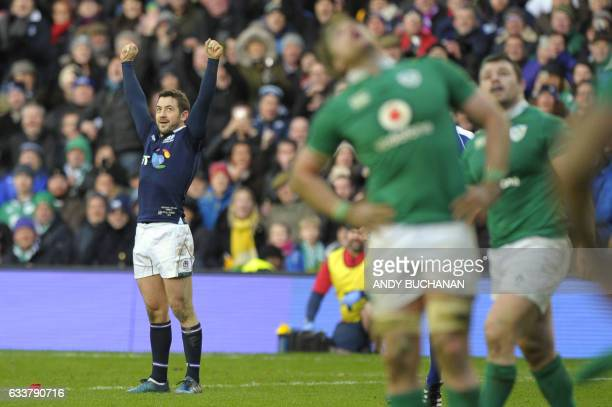 Scotland's scrumhalf Greig Laidlaw celebrates after kicking the match winning penalty during the Six Nations international rugby union match between...
